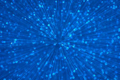 Blue glitter explosion lights abstract background Stock Image