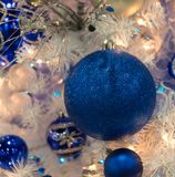 Blue Glitter Ornament on Christmas Tree Royalty Free Stock Photography