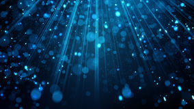 Blue glitter particles in light rays Stock Images