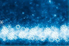 Blue glitter sparkles snow flakes background Royalty Free Stock Photography