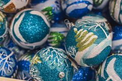 Blue glittering balls with drawn Christmas tree. New Year decoration. balls in the wooden box. New Year`s celebration. stock photography