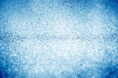 Blue glittering Christmas lights. Blurred abstract background royalty free stock photos