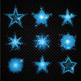 Blue glittering stars sparkling particles on transparent background.  Stock Photo