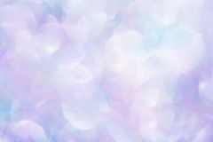 Blue Glittery Background Texture. Colorful pink and blue glitter bokeh, soft background texture royalty free stock photos