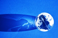 Blue globe background. A blue globe background with a shadow stock photography