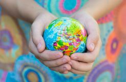 The Blue Globe with the territories of the countries of the World on a colorful background, stock image