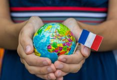 The Blue Globe with the territories of the countries of the World and the flag of France, the territory of France, stock photos