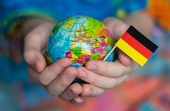 The Blue Globe with the territories of the countries of the World and the flag of Germany, the territory of Germany royalty free stock image