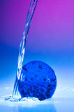 Blue globe with water drops Stock Photo