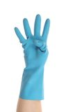 Blue glove on hand shows four. Royalty Free Stock Photos