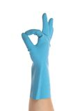Blue glove on hand shows sign ok. Stock Images