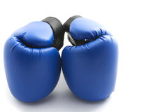 Blue gloves. Two blue boxing gloves on white background stock photos