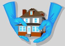 Blue gloves and house Royalty Free Stock Photo