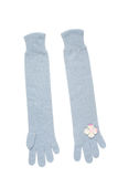 Blue gloves with small pink flowers. Blue knitted gloves with high white small pink flowers. Knits on a white background Stock Photography