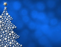 Blue glowing background. Bright white snowflake tree on glowing blue background Stock Photo