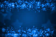 Blue glowing bokeh holiday background Stock Images