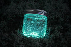 Blue glowing jar on the moss Royalty Free Stock Photos