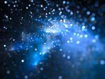 Blue glowing nebula with stars in bokeh, depth of field Royalty Free Stock Photography