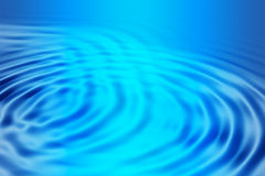 Blue glowing ripples Stock Photos