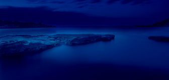 Into The Blue. Gnejna Bay before night falls Royalty Free Stock Photos