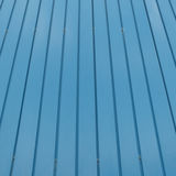 Blue goffered metal texture, corrugated steel surface. Industrial background Stock Images