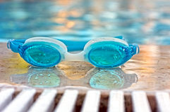 Blue goggles by the pool Stock Images