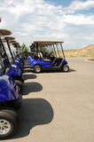 Blue Golf Carts Parked in a Row Royalty Free Stock Image