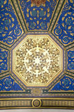 Blue and gold ceiling painting. Beautiful and colorful hexagonal blue and gold ceiling with leafs drawing Stock Photos