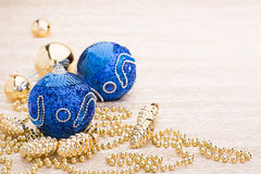 Blue and gold christmas balls. On illuminated background Royalty Free Stock Photography