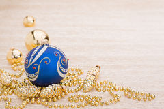Blue and gold christmas balls. On illuminated background Royalty Free Stock Images