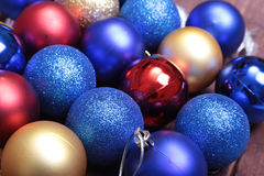Blue and gold christmas balls on a wooden background Stock Photos