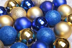 Blue and gold christmas balls on a wooden background Royalty Free Stock Photos