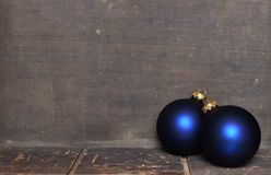 Blue & gold Christmas ornaments border on wooden background Stock Photo