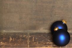 Blue & gold Christmas ornaments border on wooden background Royalty Free Stock Images