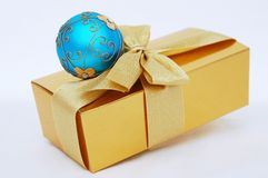 Blue Gold Christmas present. Gold christmas box and blue ball royalty free stock images