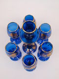 Blue Gold Crystal Deco Glass Items Circular Format. Exquisite Dark Blue Gold trimmed Crystal Decorative Glass items circular formation royalty free stock image