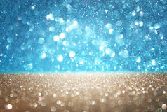 Blue and gold defocused lights background. abstract bokeh lights Stock Images