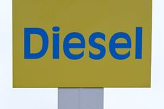 Blue and gold Diesel sign in white Royalty Free Stock Image