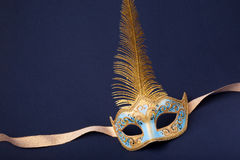 Blue and gold feathered mask Stock Photo