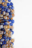 Blue and gold bead border Stock Photos