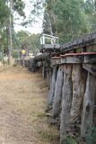 A blue and gold heritage Victorian Railways Y class diesel engine approaches the wooden trestle bridge near Muckleford railway sta. MUCKLEFORD, AUSTRALIA royalty free stock photo