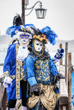 Blue and gold masked carnaval couple Royalty Free Stock Photo