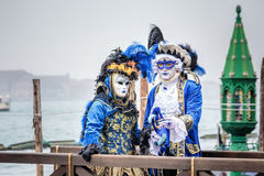 Blue and gold masked carnaval couple Stock Photo
