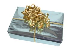 Blue & Gold Present. Gold Bow & ribbon on blue mettalic wrap Stock Images