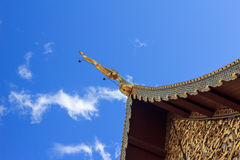 Blue and Gold. Temple golden crest and blue sky Royalty Free Stock Images