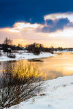 Blue, Gold And White. A golden sunset by the river. The sun sets already at five o'clock in March in the Northern Finland stock images