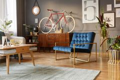 Blue and golden armchair stock photography
