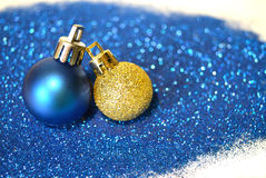 Blue and golden Christmas balls on blue glitter on white background Stock Photo