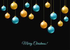 Blue  and golden  hanging Christmas balls  on black  background. Stock Photos