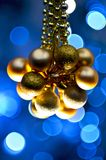 Blue Golden Ornaments. Golden Christmas Ornaments and Blue Background - Bokeh Lights Royalty Free Stock Image